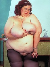 Huge BBW model naked and playing with...
